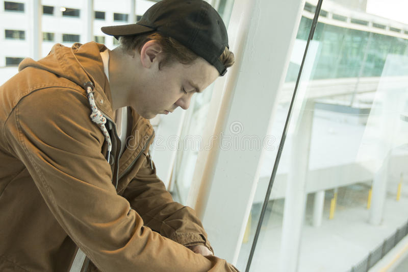 Teenager thinking in tunnel area stock photo
