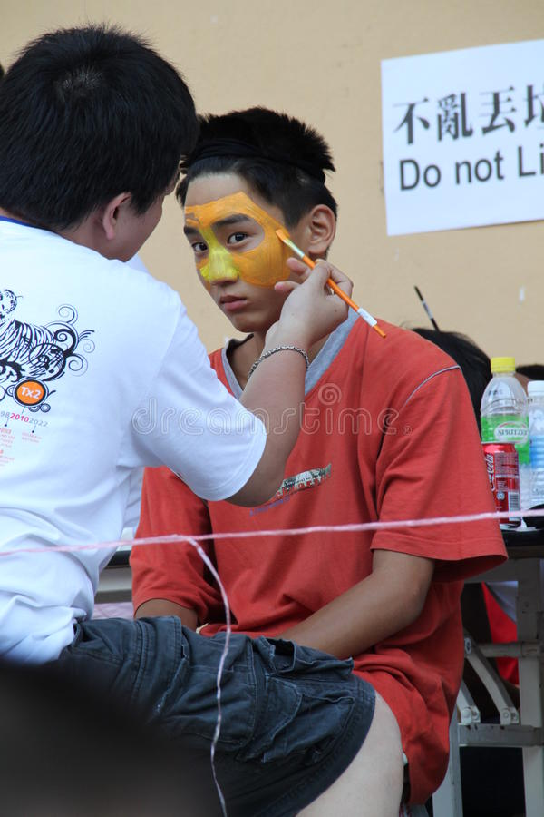 Teenager with tiger face painting stock images