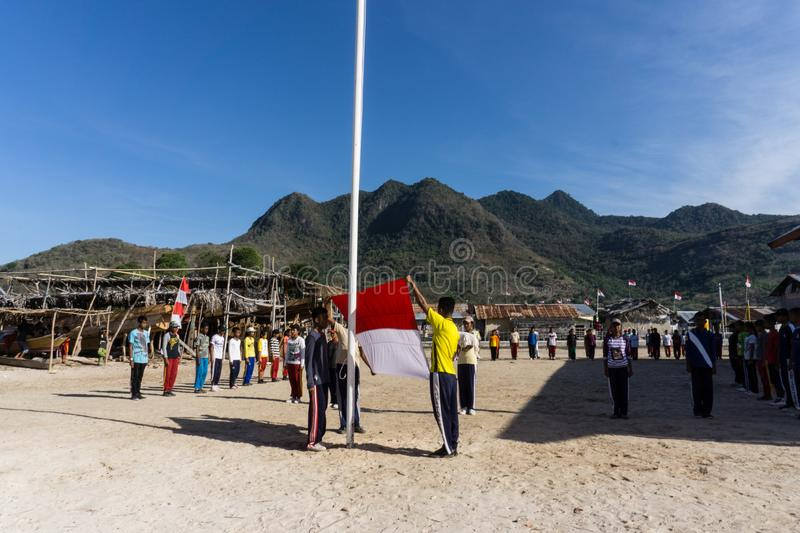Teenager train for Indonesia independent day in the small island with mountain at the background royalty free stock photography