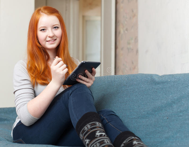 Teenager  uses tablet computer or electronic book