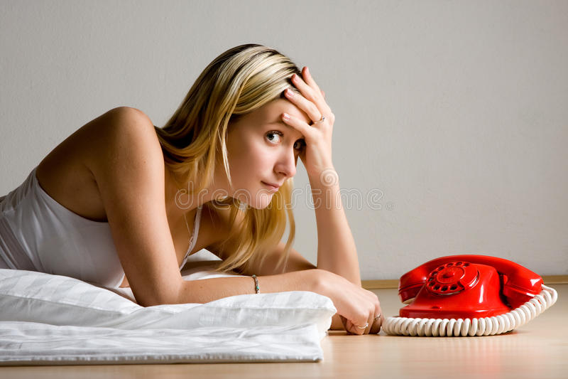 Download Teenager Waiting By Phone Royalty Free Stock Photo - Image: 12410325