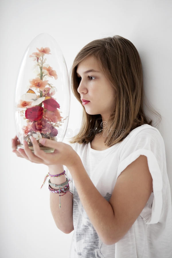 Teenager is watching a glass jar royalty free stock image