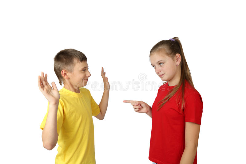 Teenagers. Accusation and acquittal gesture - teenage boy and girl in yellow and red t-shirts stand in full height isolated on white background royalty free stock photography
