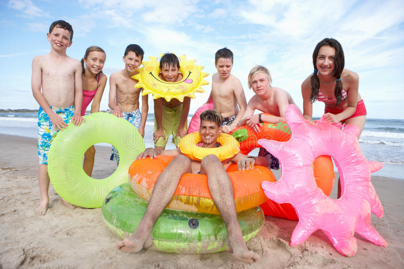 Teenagers on beach royalty free stock images