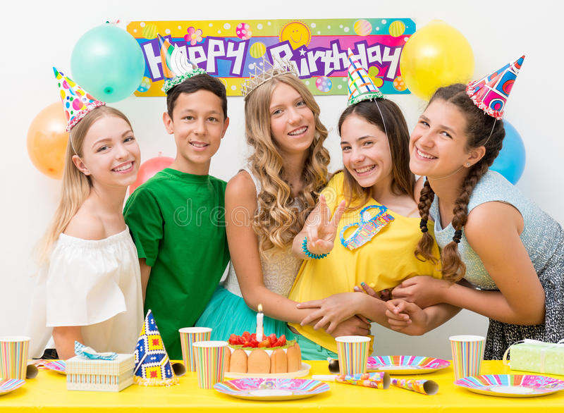 Teenagers at a birthday party. Group of happy teenagers at a birthday party stock photography