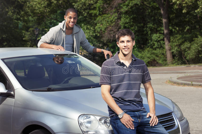 Teenagers with car. Young teenage drivers with car royalty free stock photos