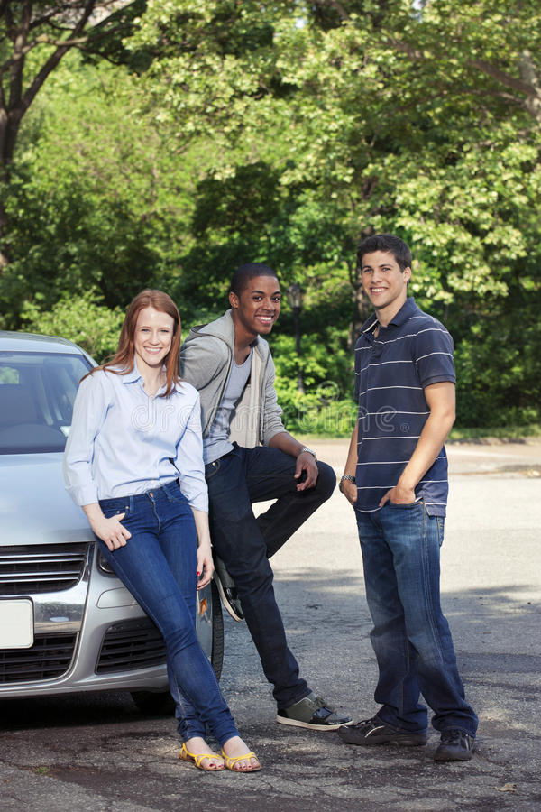 Teenagers with car. Young teenage drivers with car royalty free stock images