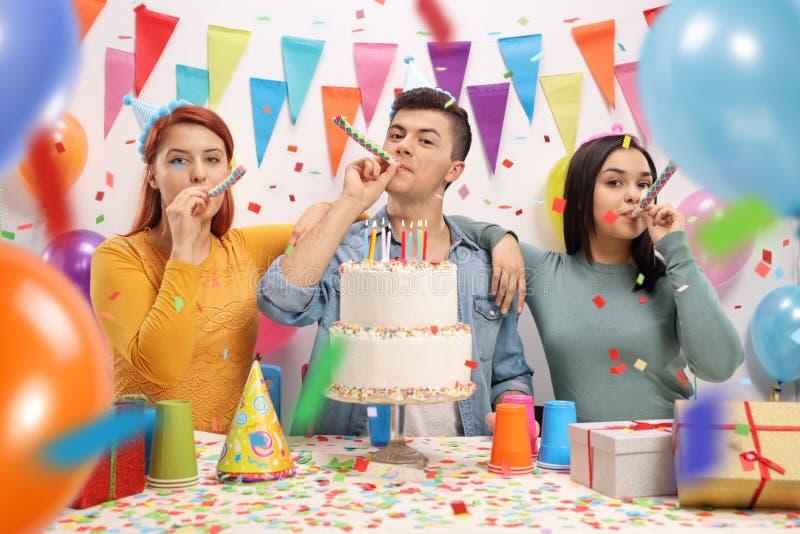 Teenagers celebrating a birthday stock photos