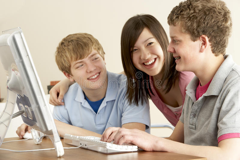 Teenagers on Computer at Home. Laughing royalty free stock images
