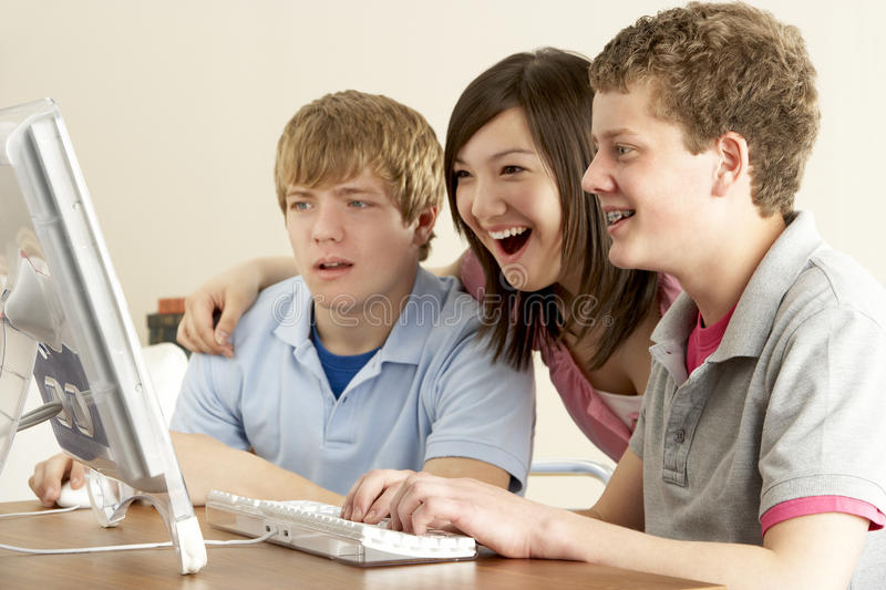 Teenagers on Computer at Home. Looking Shocked stock photos