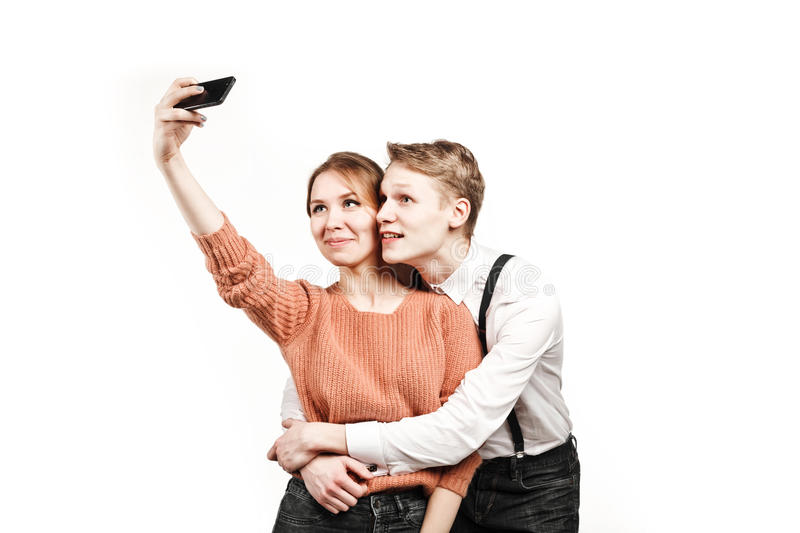 Teenagers couple making selfie by smartphone stock photos