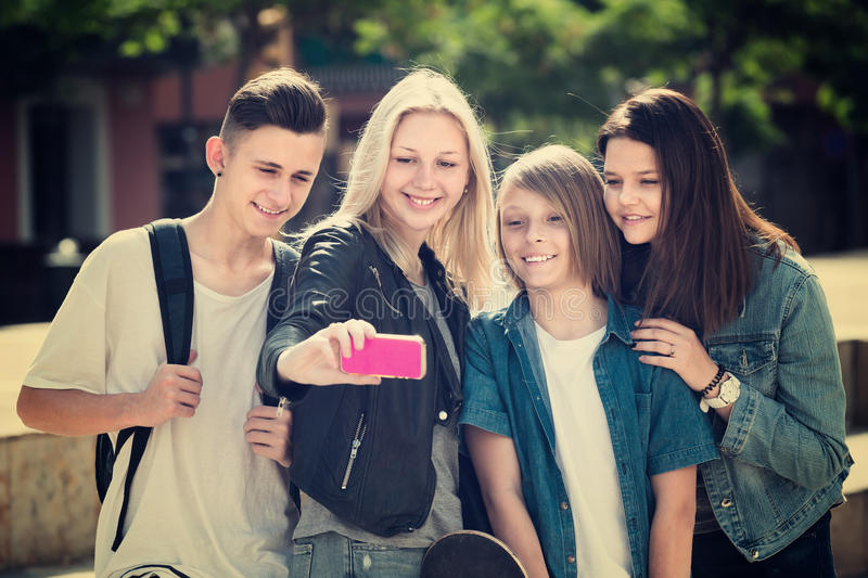 Teenagers doing selfie outdoors stock photos