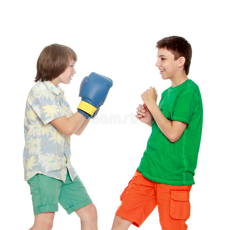 Teenagers fight each other. Two teenager boy Boxing each other-Isolated on white background royalty free stock photos