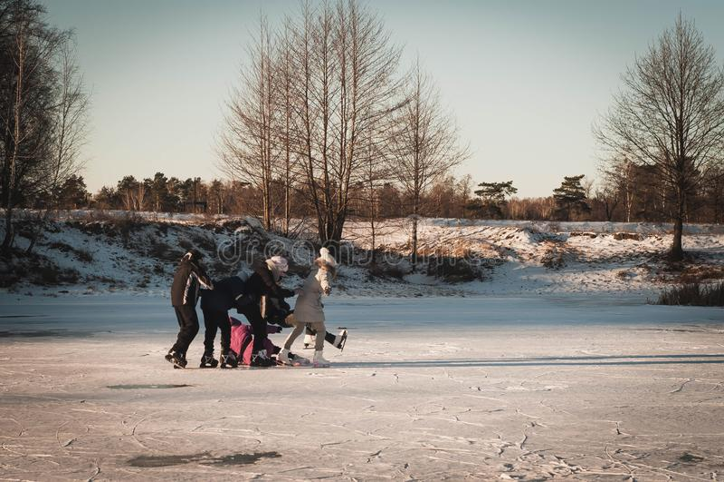 Teenagers frolic on the ice, winter fun girl skating stock image