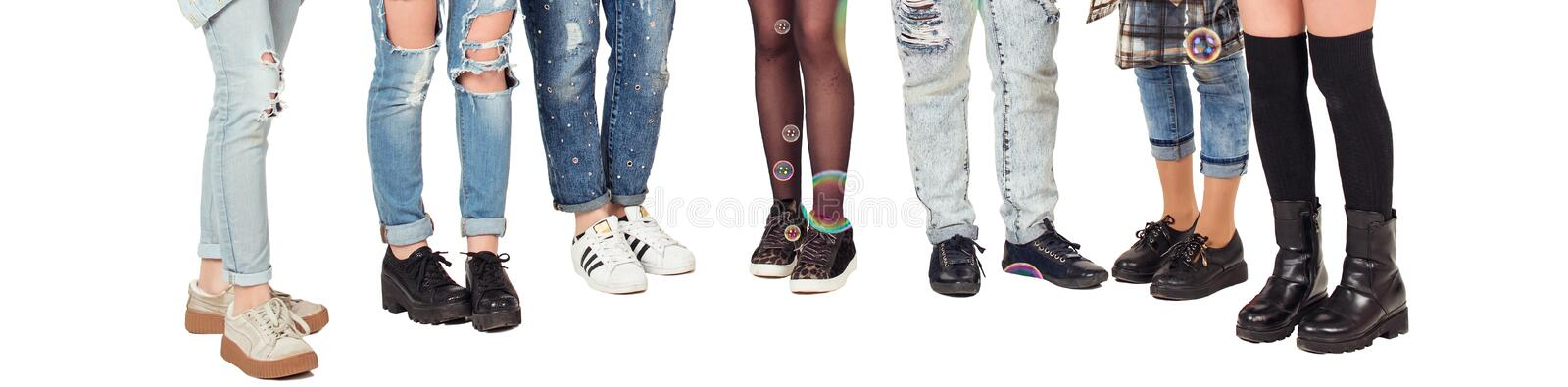 Teenagers girls have fun together with bubble. Stylish teens legs isolated on white. Birthday party with bubble. Group of school g royalty free stock photography