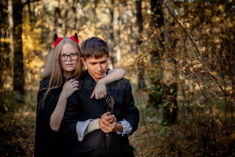 Teenagers in Halloween costumes in the woods stock images