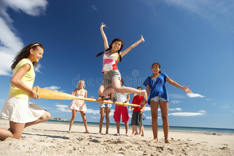 Download Teenagers Having Fun On Beach Stock Image - Image of male, competition: 21401185