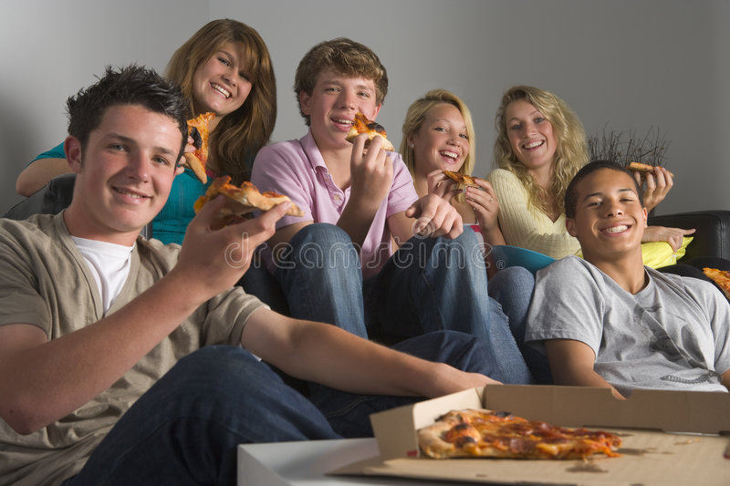 Teenagers Having Fun And Eating Pizza Stock Images