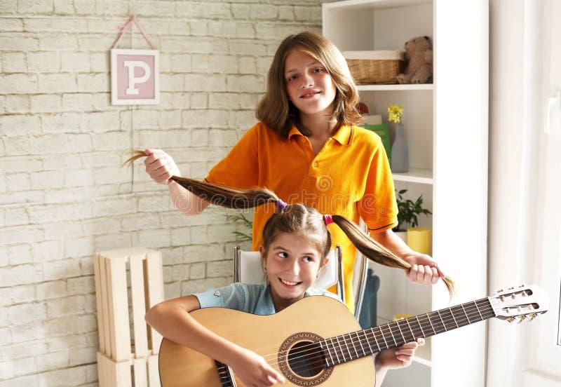 Teenagers having fun with a guitar stock photos