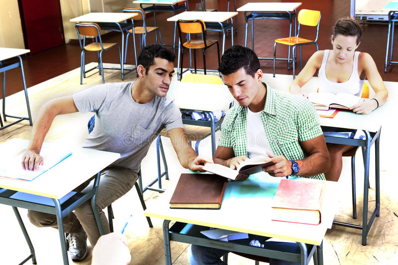 Teenagers help in the review of lesson royalty free stock photography