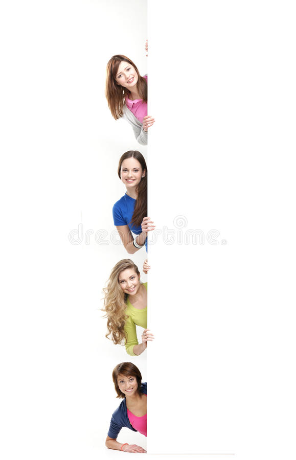 Teenagers holding a large white banner royalty free stock photography