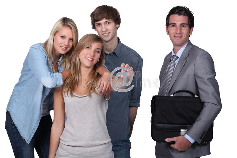Download Teenagers Holding The @ Sign Stock Image - Image: 26320303