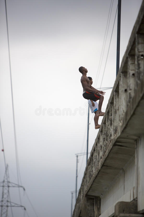 Teenagers jumping back side from a bridge, Ecuador stock image