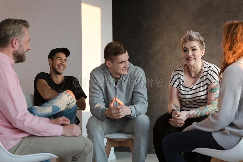 Teenagers laughing during a group counseling session for youth. With emotional and behavioral problems stock photos