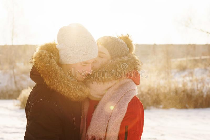 Teenagers in love. Date in winter. Adolescents in love on date in winter. Girl kisses her boyfriend. Joy of being together. First love. Concept for Valentine`s royalty free stock photos