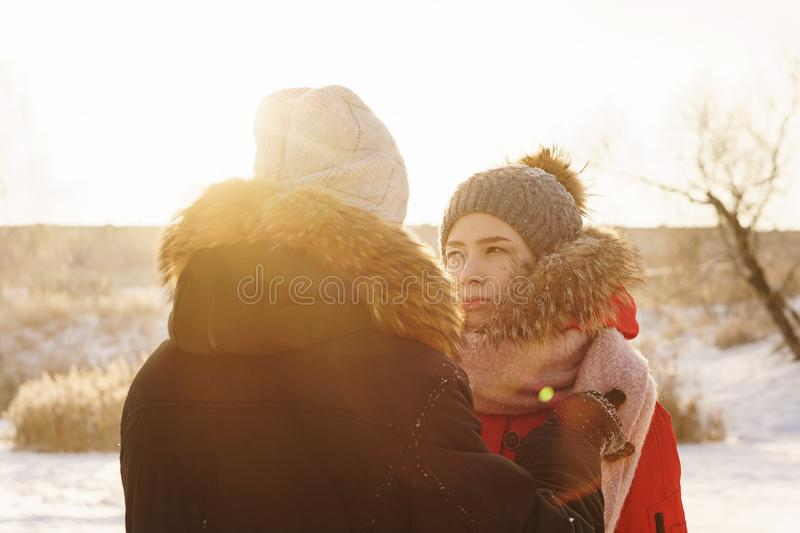 Teenagers in love. Date in winter. Adolescents in love on a date in winter. Guy and girlfriend are talking. Concept for Valentine`s Day stock image