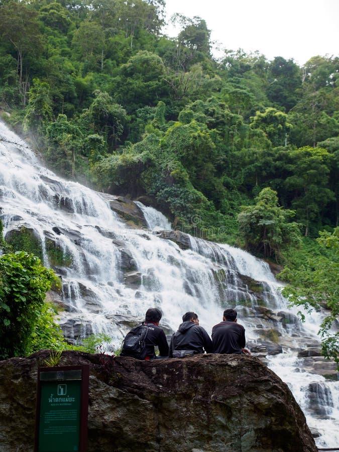 Teenagers at mae Ya waterfall, vertical, Chiang Mai, Thailand royalty free stock photos