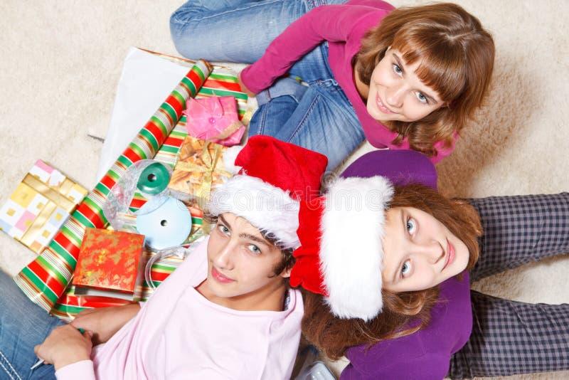 Teenagers making Christmas presents stock photos