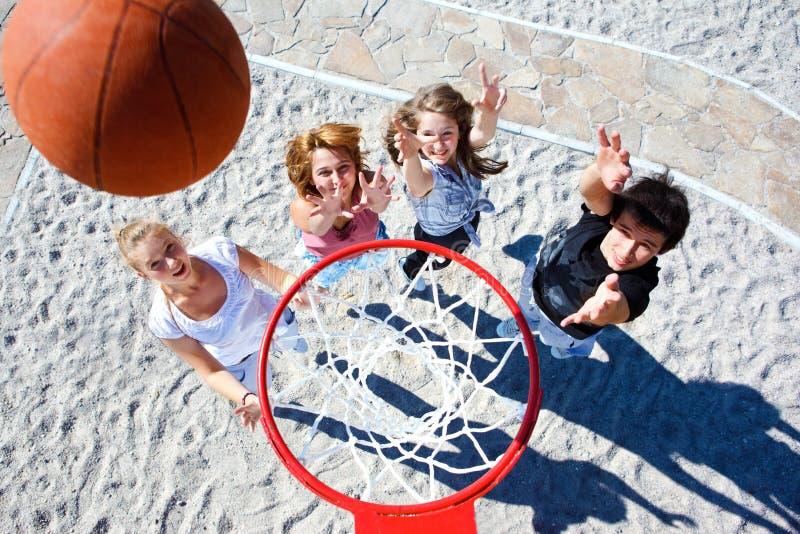 Teenagers playing basketball royalty free stock photos