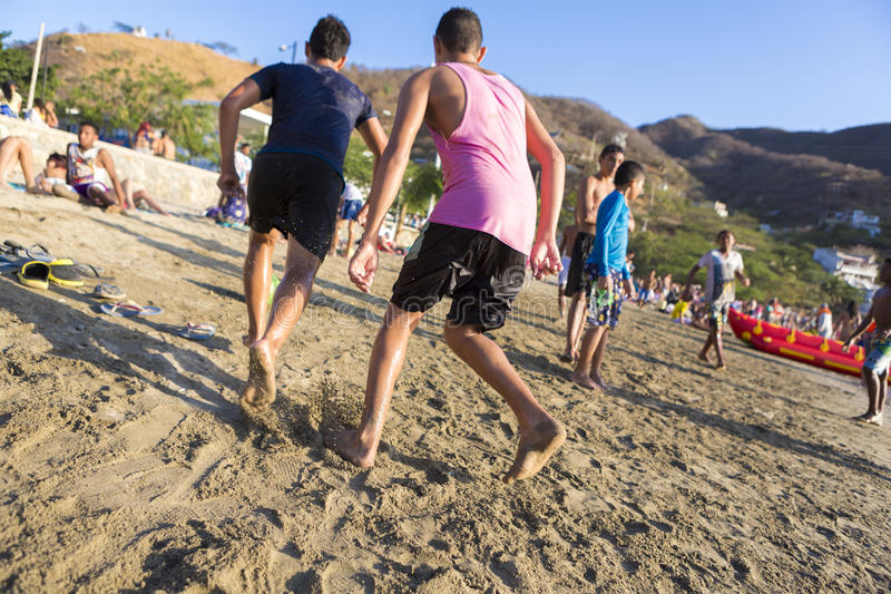 Teenagers playing on beach of Taganga in Colombia royalty free stock image
