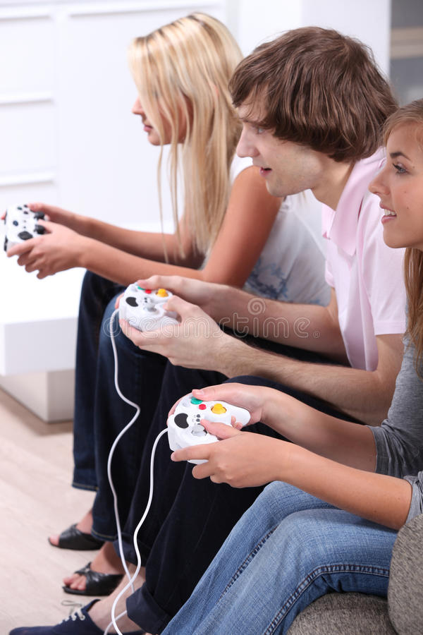 Teenagers playing computer games. At home stock images