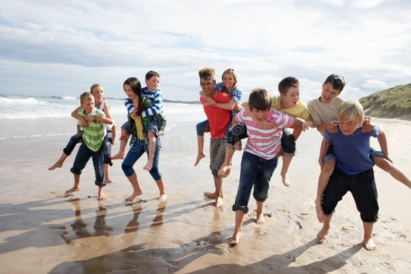 Teenagers playing piggyback stock photos