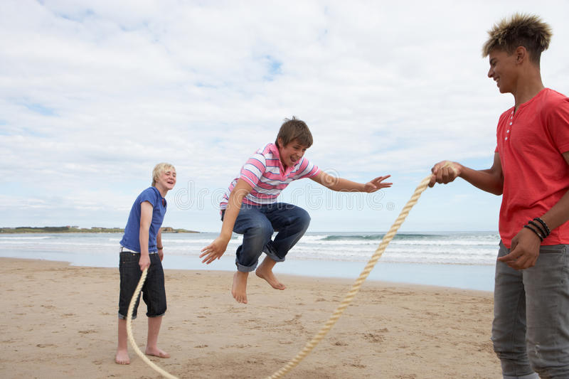 Teenagers playing skipping rope royalty free stock photos