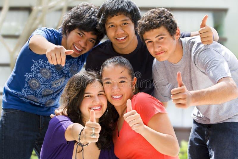 Teenagers posing outside school stock photo