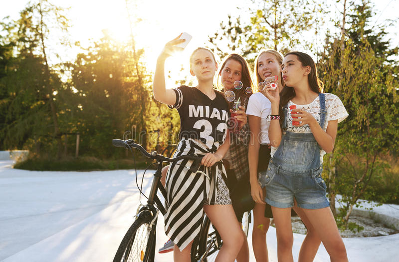 Teenagers psong for selfie. Outside while having fun royalty free stock photos