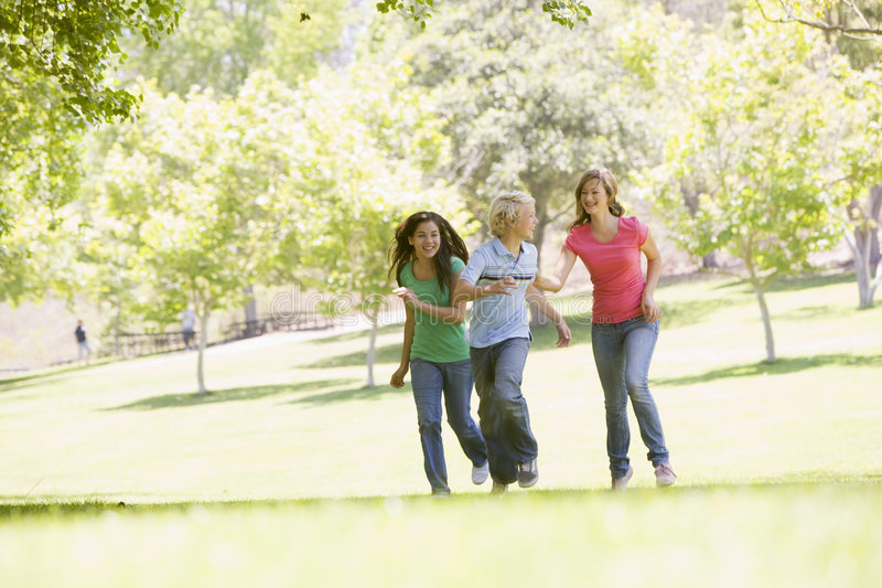 Download Teenagers Running Through Park Stock Photo - Image: 6883110