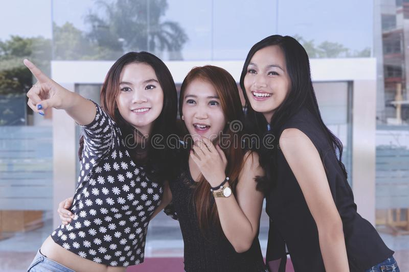 Teenagers smiling taking self portrait stock photography