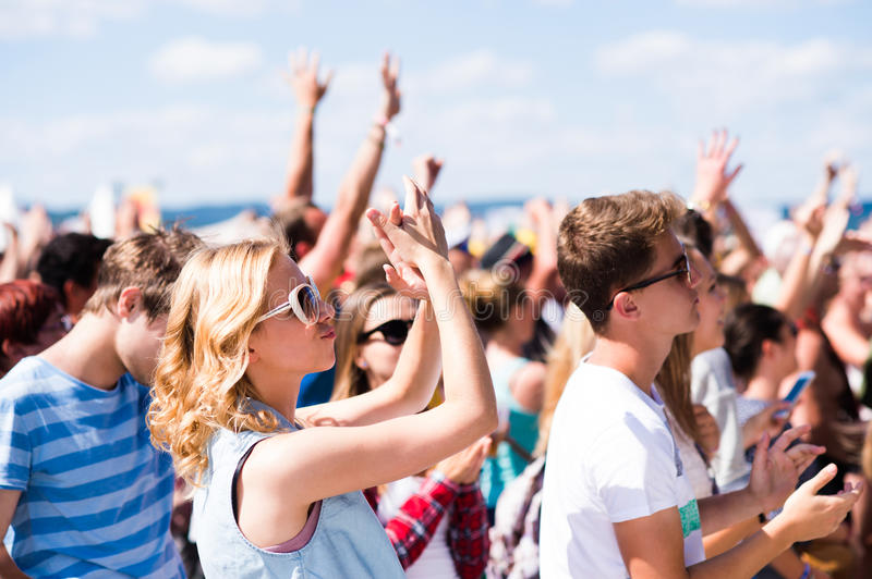 Teenagers at summer music festival having good time royalty free stock photography