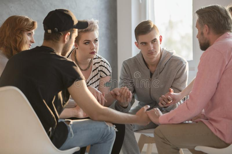 Teenagers talking with addiction counselor stock images