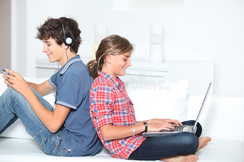 Teenagers and technology royalty free stock photo