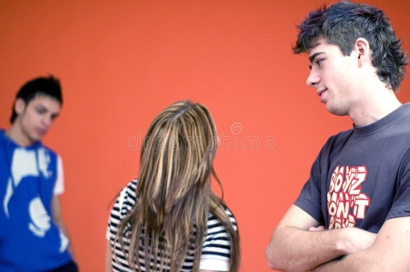 Teens. Three teens posed on an orange background royalty free stock image