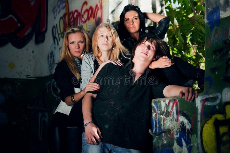 Young Fashion People At The Graffiti Wall Stock Photos