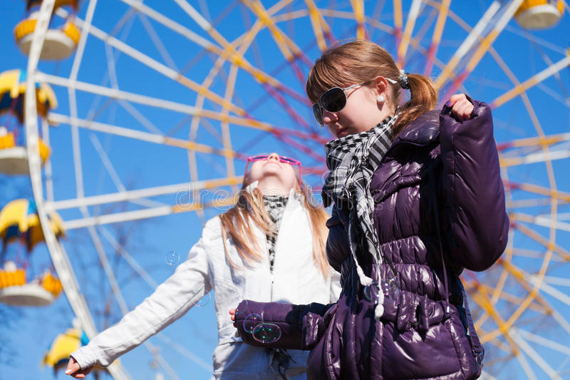 Download Teens Against A Ferris Wheel Stock Image - Image: 20084883