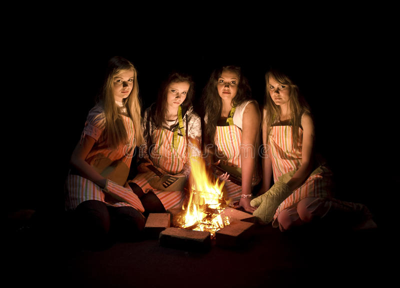 Teens around campfire royalty free stock photos