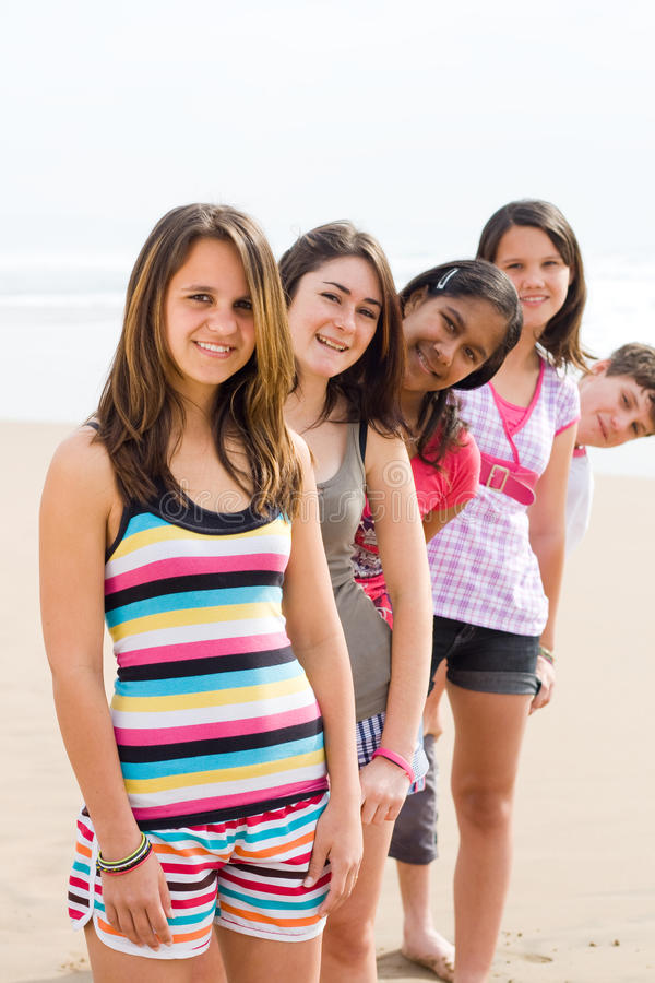 Download Teens on beach stock photo. Image of people, line, friend - 10970984