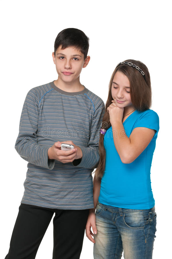 Teens with a cell phone stock images